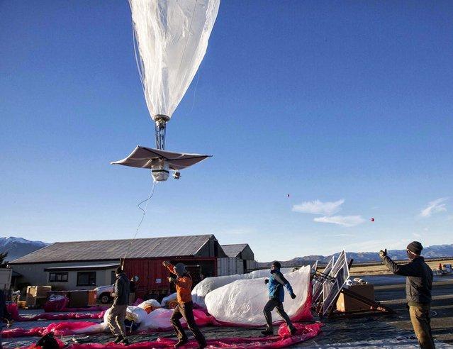 A Google team releases a balloon in Tekapo. (Photo by Andrea Dunlap/Google)