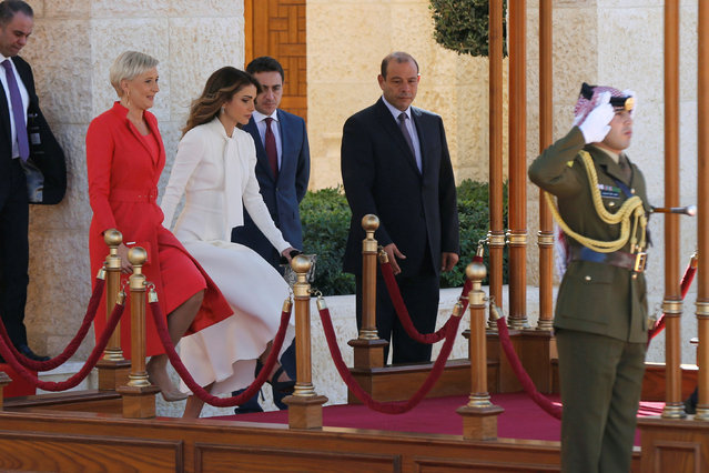 Jordan's Queen Rania (R) walks with Polish President Andrzej Duda's wife Agata Kornhauser-Duda to review Bedouin honour guards at the Royal Palace in Amman, Jordan, November 6, 2016. (Photo by Muhammad Hamed/Reuters)