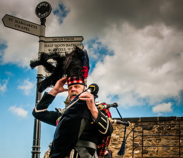 """Gone with the wind"". A bagpiper waiting for a wedding party almost loses his hat on a windy day in Edinburgh, Scotland. (Photo and caption by Lola Akerstrom/National Geographic Traveler Photo Contest)"