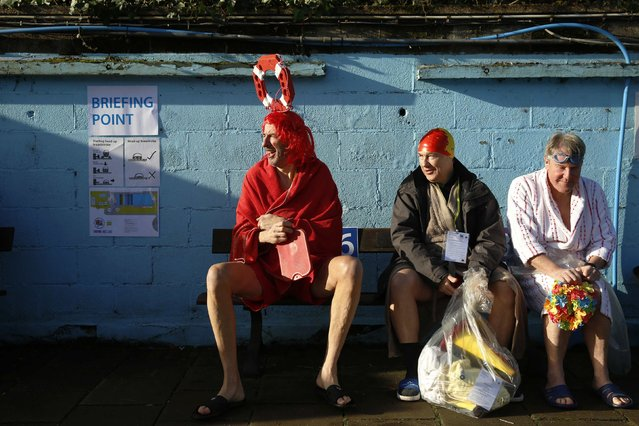 Swimmers wait for their race during the UK Cold Water Swimming Championships at Tooting Bec Lido in south London January 24, 2015. (Photo by Luke MacGregor/Reuters)