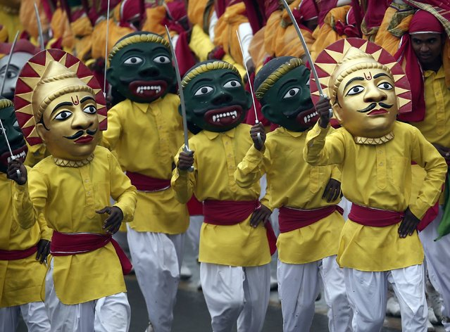 Artists wearing masks perform as they take part in the Republic Day parade in New Delhi January 26, 2015. (Photo by Ahmad Masood/Reuters)