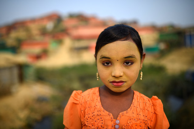 """Zannat Ara, nine. """"I wear makeup to keep my face clean and there are some insects that bite my face and this keeps them away, so this protects me"""". (Photo by Clodagh Kilcoyne/Reuters)"""