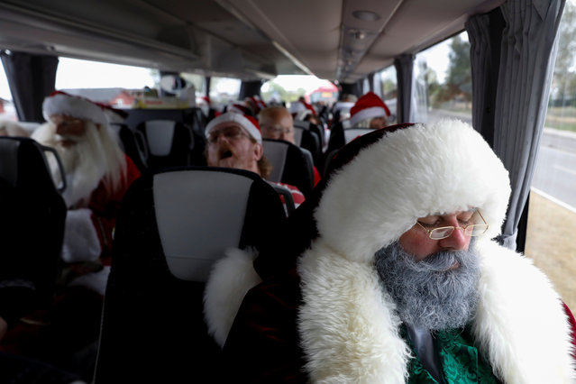 People dressed as Santa Claus rest while on a bus trip between events during the World Santa Claus Congress, an annual event held every summer in Copenhagen, Denmark, July 23, 2018. (Photo by Andrew Kelly/Reuters)
