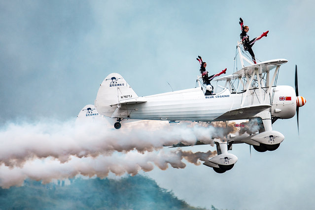 Katie Rose Hobbs and Kirsten Elizabeth Pobjoy of British Aerosuperbatics Wingwalking Team perform ballet in the air during Huangguoshu Waterfalls Flight Conference on August 3, 2018 in Anshun, Guizhou Province of China. Huangguoshu Waterfalls Flight Conference including 18 aircraft from seven aerobatic teams from all over the world kicked off on Friday. (Photo by VCG via Getty Images)