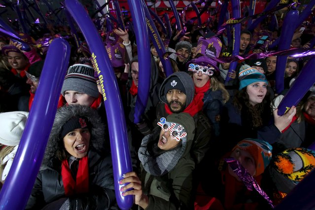 Revelers gather during New Year celebrations in Times Square in the Manhattan borough of New York December 31, 2015. (Photo by Andrew Kelly/Reuters)