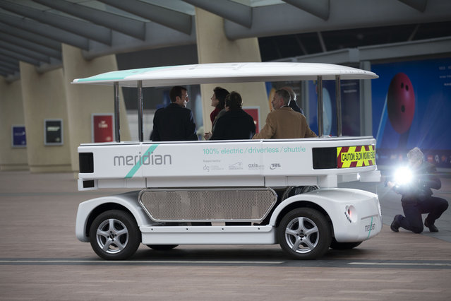 Dignitaries try out a prototype driverless car called a Meridian shuttle during a launch event for the media near the O2 Arena in London, Wednesday, February 11, 2015. (Photo by Matt Dunham/AP Photo)