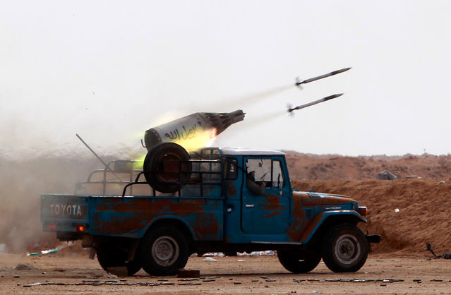 Rebel fighters launch rockets against Qaddafi forces at the frontline along the western entrance of Ajdabiyah on April 21. (Photo by Amr Abdallah Dalsh/Reuters)
