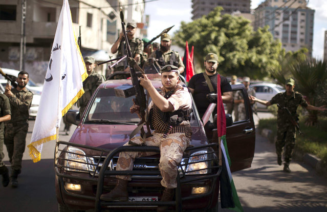 """Armed Palestinian Hamas security forces patrol the streets of Gaza City on September 25, 2013. Egypt's Foreign Minister Nabil Fahmy has warned Hamas of a """"harsh response"""" if the Palestinian Islamist movement that rules the neighbouring Gaza Strip threatened Egypt's national security. (Photo by Mahmud Hams/AFP Photo)"""