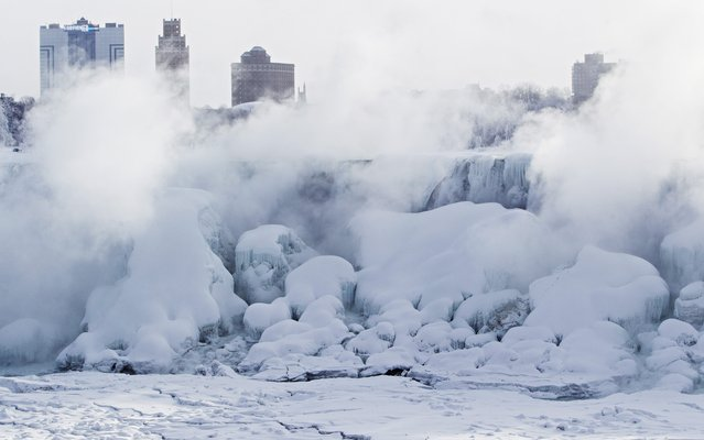 Masses of ice form  in the lower Niagara River and around the American Falls as seen from Niagara Falls, Ontario, Canada, Thursday, February 19, 2015. (Photo by Aaron Lynett/AP Photo/The Canadian Press)