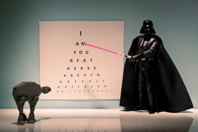 Darth Vader points at an opticians letter chart, taken in Glasgow, Scotland, December 2016. (Photo by David Gilliver/Barcroft Images)