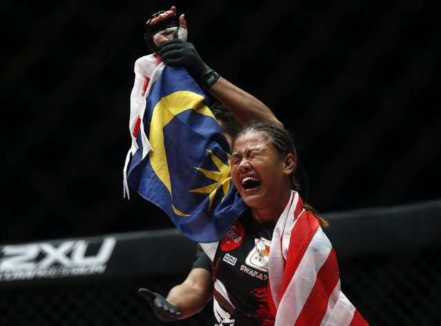 Malaysia's Ann Osman celebrates winning her mixed martial arts (MMA) ONE Championship fight against Egypt's Walaa Abbas in Kuala Lumpur, March 13, 2015. (Photo by Olivia Harris/Reuters)