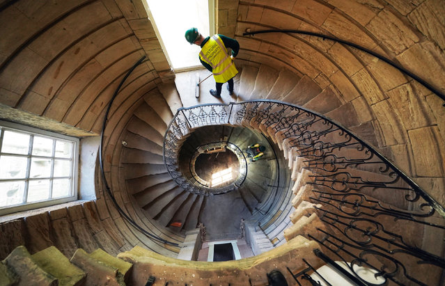 Workers on the east spiral staircase which sits one end of the Central Hall at the National Trust's Seaton Delaval Hall in Northumberland, England on September 22, 2020, which has undergone restoration after still bearing scars from a fire dating back to 1822. (Photo by Owen Humphreys/PA Images via Getty Images)