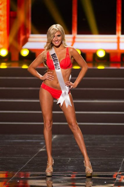 A handout picture provided by the Miss Universe Organization shows Noemie Happart, Miss Belgium 2013, competing in the swimsuit competition during the Preliminary Competition at the Crocus City Hall, in Moscow, Russia, 05 November 2013. (Photo by Darren Decker/EPA)