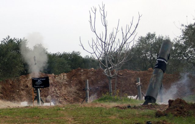 Rebel fighters from Suqour al-Sham Brigade launch locally made shells towards forces loyal to Syria's president Bashar Al-Assad in Idlib countryside March 19, 2015. (Photo by Mohamad Bayoush/Reuters)