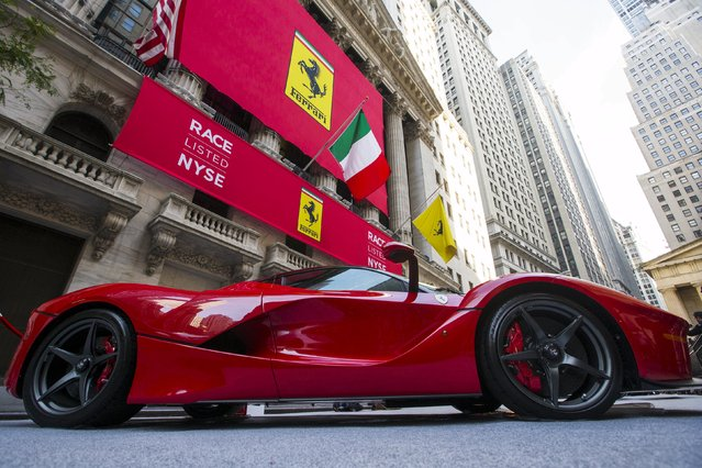A Ferrari is seen outside the New York Stock Exchange, United States in this October 21, 2015 file photo. Ferrari is expected to report Q4 and full-year results this week. (Photo by Lucas Jackson/Reuters)