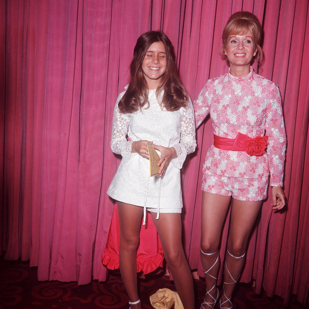"Carrie Fisher and her mother, Debbie Reynolds, in 1971. Carrie Fisher who played Princess Leia in the original ""Star Wars"" died Tuesday, December 27, 2016 after heart attack on flight from London to LA on Friday. She was 60. (Photo by Globe Photos/Rex Features/Shutterstock)"