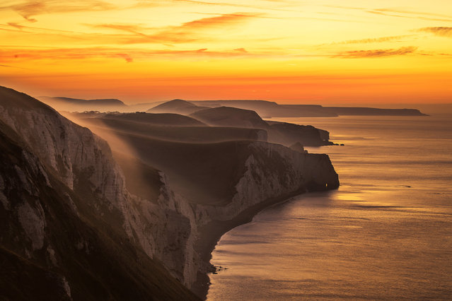 Sunrise in Dorset Weather input – colourful sunrise on the Jurassic coast Sunrise at the White Nothe, east of Ringstead, Jurassic coast, Dorset, UK. (Photo by Dave Lawrence/Solent News & Photo Agency)