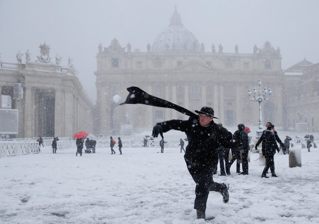 A young priest throws a snowball during a heavy snowfall in Saint Peter's Square at the Vatican, February 26, 2018. (Photo by Max Rossi/Reuters)