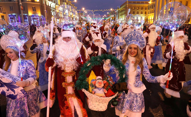 People dressed as Father Frost and Snow Maiden take part in a march on Christmas Eve in centre of Minsk, Belarus on December 24, 2018. (Photo by Vasily Fedosenko/Reuters)