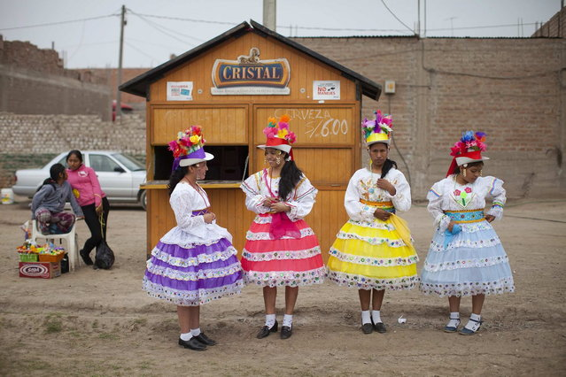 Andean women wearing traditional clothes attend a national scissors dance competition in the outskirts of Lima December 1, 2013. (Photo by Enrique Castro-Mendivil/Reuters)