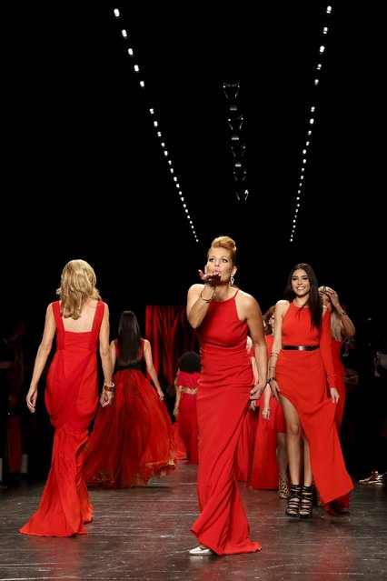 Candace Cameron-Bure blows a kiss after she presents a creation during the American Heart Association's (AHA) Go Red For Women Red Dress Collection, presented by Macy's at New York Fashion Week February 11, 2016. (Photo by Andrew Kelly/Reuters)