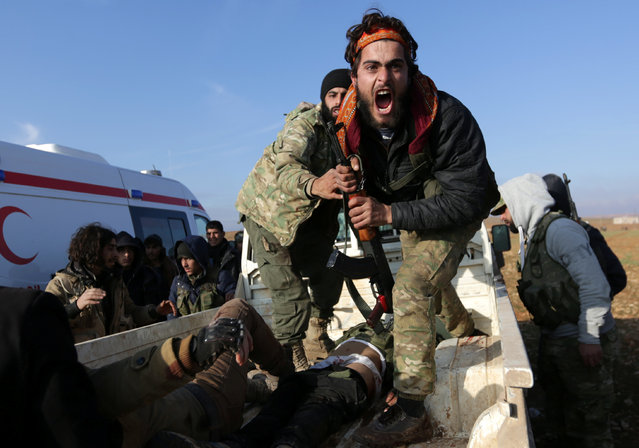 A Free Syrian Army (FSA) fighter reacts as he mourns near the body of his brother, who was an FSA fighter and died during an offensive against Islamic State fighters to take control of Qabasin town, on the outskirts of the northern Syrian town of al-Bab, Syria January 10, 2017. (Photo by Khalil Ashawi/Reuters)