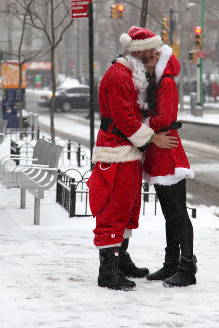 Matt (L), and Heather (R), form Hoboken, NJ celebrates SantaCon day in Brooklyn on Saturday, December 14, 2013. Also New Yorkers dressed as Santa Claus during the annual SantaCon event in Brooklyn. (Photo by Riyad Hasan)
