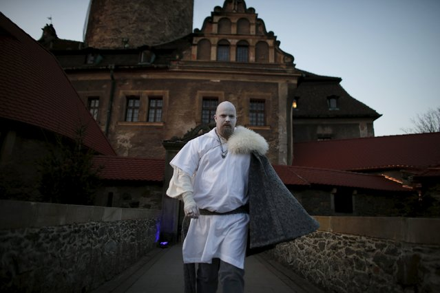 A participant walks in front of the castle before the role play event at Czocha Castle in Sucha, west southern Poland April 9, 2015. (Photo by Kacper Pempel/Reuters)