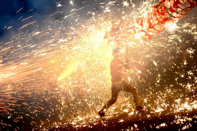 Ethnic Miao people celebrate Lantern Festival with fireworks in Taijiang, Guizhou Province, China, February 22, 2016. (Photo by Reuters/Stringer)