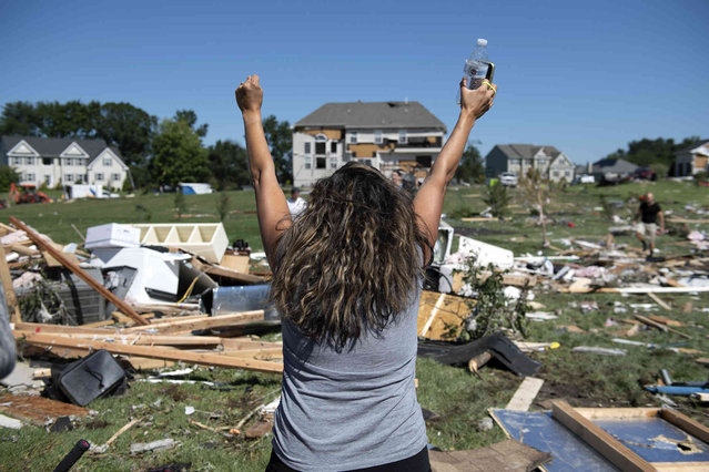 Ashley Thomas cheers upon finding her purse after her home was damaged  by a tornado in Mullica Hill, N.J. Thursday, September 2, 2021. A stunned U.S. East Coast woke up Thursday to a rising death toll, surging rivers and destruction after the remnants of Hurricane Ida walloped the region with record-breaking rain, filling low-lying apartments with water and turning roads into car-swallowing canals. (Photo by Joe Lamberti/Camden Courier-Post via AP Photo)
