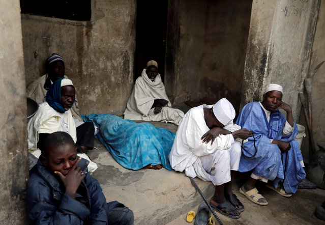 A family mourns the death of a man killed by suspected militants during an attack around Polo area of Maiduguri, Nigeria on February 16, 2019. (Photo by Afolabi Sotunde/Reuters)