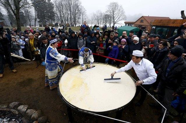 Employees prepare the dough for frying dranik, a potato pancake that is the national dish of Belarus, in the Sula History Park near the village of Sula, Belarus March 7, 2016. (Photo by Vasily Fedosenko/Reuters)