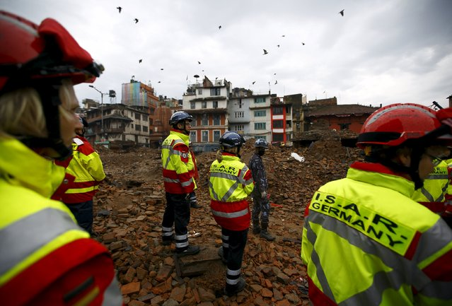 Members of German rescue team work near the collapsed temple in search of victims after the earthquake in Kathmandu, Nepal April 28, 2015. (Photo by Navesh Chitrakar/Reuters)