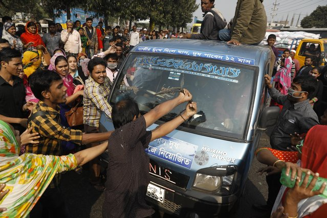 Bangladeshi garment workers vandalize a vehicle during a protest in Savar, on the outskirts of Dhaka, Bangladesh, Wednesday, January 9, 2019. Thousands of garment workers have staged demonstrations to demand better wages for the fourth straight day, shutting down factories on the outskirts of Bangladesh's capital. Bangladesh has the second-largest garment-export industry in the world after China and makes clothes for big-name retailers. (Photo by AP Photo/Stringer)