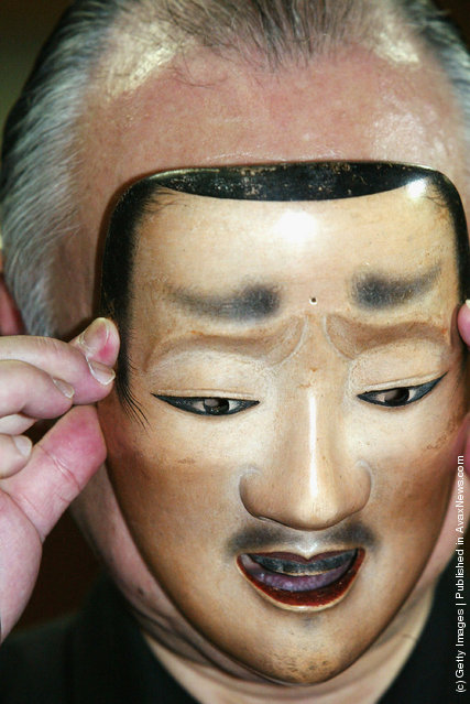 A renowned Noh actor, Otoshige Sakai, demostrates how to put on a Noh mask