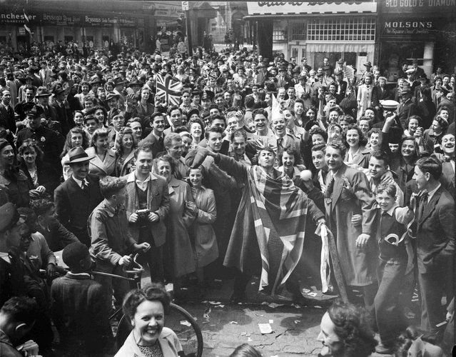 A crowd celebrates VE-Day in Montreal, Quebec, May 8, 1945, in this handout photo provided by Library and Archives Canada. (Photo by Reuters/Montreal Star/Library and Archives Canada)