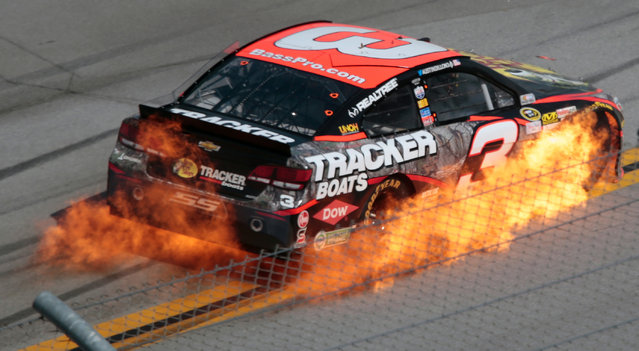 Austin Dillon's car catches fire during the Talladega 500 NASCAR Sprint Cup Series auto race at Talladega Superspeedway, Sunday, May 3, 2015, in Talladega, Ala. (Photo by Butch Dill/AP Photo)