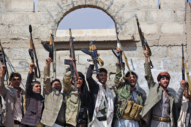 In this December 15, 2015, file photo, Shiite tribesmen, known as Houthis, hold their weapons as they chant slogans during a tribal gathering showing support for the Houthi movement in Sanaa, Yemen. Saudi Arabia traded 109 Yemeni prisoners taken during its coalition war against Shiite rebels there for nine Saudis, authorities said Monday, March 27, 2016 the latest prisoner exchange ahead of a scheduled April cease-fire and peace talks. (Photo by Hani Mohammed/AP Photo)
