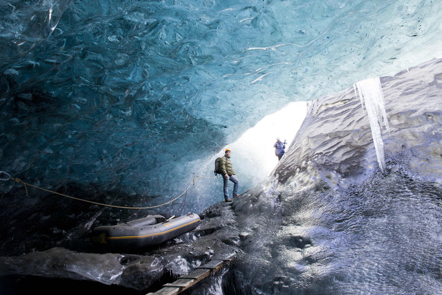 A wide view of Rob Lott emerging from the crystal ice cave in the Vatnajokull Glacier, Iceland. (Photo by Rob Lott/Barcroft Media)
