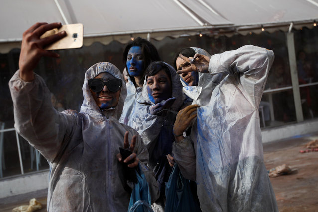 """Revellers take a """"selfie"""" as they celebrate """"Ash Monday"""" by participating in a colourful """"flour war"""", a traditional festivity marking the end of the carnival season and the start of the 40-day Lent period until the Orthodox Easter,in the port town of Galaxidi, Greece, February 27, 2017. (Photo by Alkis Konstantinidis/Reuters)"""