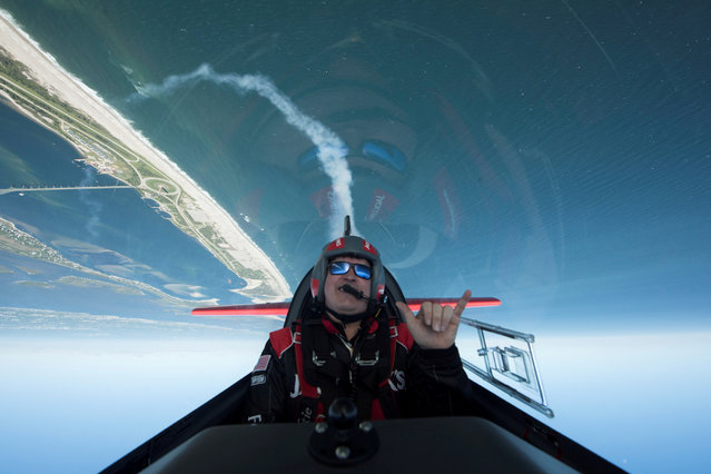 Aerobatic pilot John Klatt takes to the skies for practice ahead of the Bethpage Air Show as part of a Memorial Day event at Jones Beach on Long Island, New York, U.S., May 24, 2019. (Photo by Johnny Milano/Reuters)