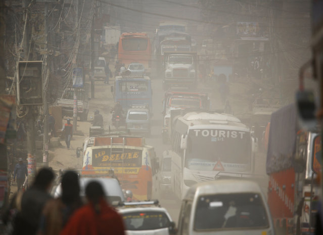 Dust blows as vehicles run along a road in Kathmandu, Nepal February 27, 2017. (Photo by Navesh Chitrakar/Reuters)