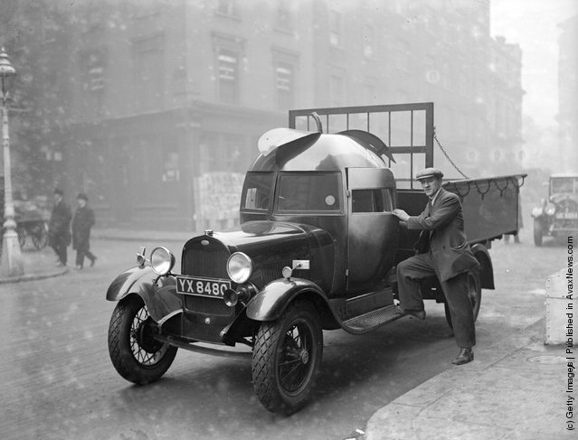 1928: A fruit importer's lorry at Covent Garden, London, with its driver's cabin in the shape of an apple