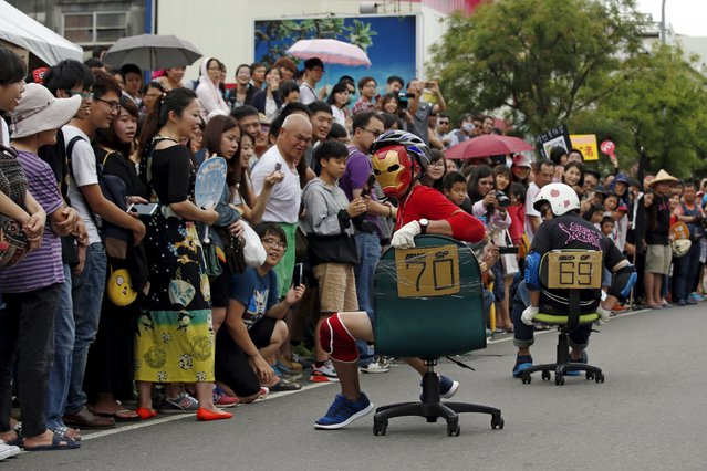 Competitors take part in the office chair race ISU-1 Grand Prix in Tainan, southern Taiwan April 24, 2016. (Photo by Tyrone Siu/Reuters)