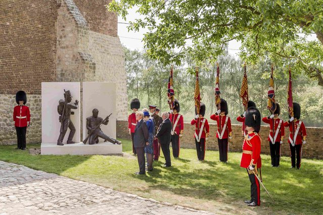 General view after Britain's Prince Charles (hidden) unveiled a monument during a ceremony for the opening of the Hougoumont farm as part of the bicentennial celebrations for the Battle of Waterloo, near Waterloo, Belgium June 17, 2015. The commemorations for the 200th anniversary of the Battle of Waterloo will take place in Belgium on June 19 and 20. REUTERS/Geert Vanden Wijngaert/Pool