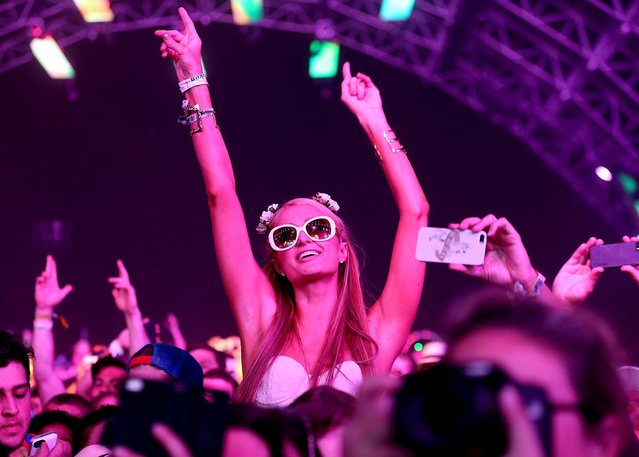 Paris Hilton watches Empire of the Sun perform. (Photo by Mark Davis/Getty Images for Coachella)