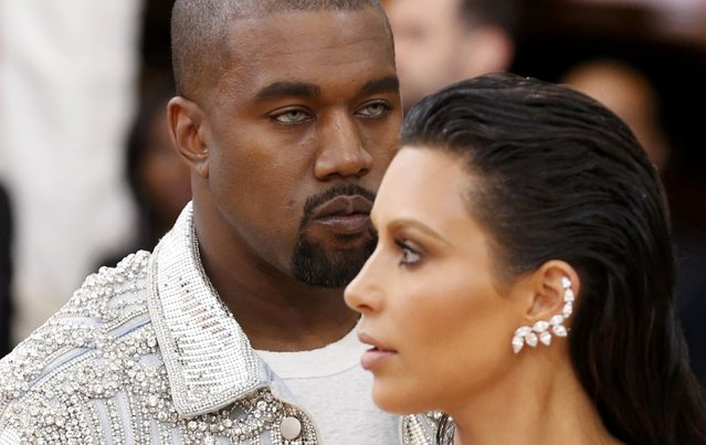 """Musician Kanye West (L) and wife Kim Kardashian arrive at the Metropolitan Museum of Art Costume Institute Gala (Met Gala) to celebrate the opening of """"Manus x Machina: Fashion in an Age of Technology"""" in the Manhattan borough of New York, May 2, 2016. (Photo by Lucas Jackson/Reuters)"""
