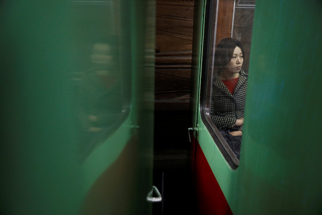 A woman travels on subway in central Pyongyang, North Korea on April 14, 2017. (Photo by Damir Sagolj/Reuters)