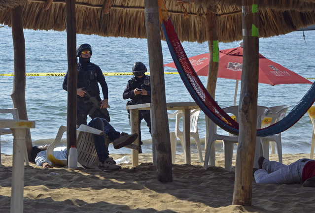 In this January 6, 2017 file photo, state police inspect the site where two men were shot at the Tamarindos beach in the port city of Acapulco, Mexico. Mexico has surpassed 2,000 murders in a month for the first time since the summer of 2011, and had more murders in the first quarter of 2017 than in the start of any year in at least two decades, according to data released Friday, April 20, 2017. (Photo by Bernandino Hernandez/AP Photo)