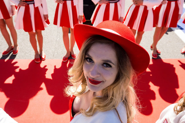 A grid girl poses for a photo at the Formula One Russian Grand Prix at the Sochi Autodrom circuit in Sochi, Russia, April 30, 2017. (Photo by Andrej Isakovic/AFP Photo)